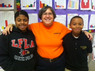 Susan Kelter with 6th graders Tylea Wilson and Malik Qualls.