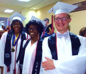 Chris with classmates at graduation