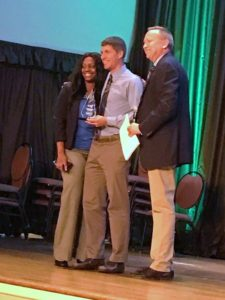 Mr. Malone is joined by Dr. Katrice Noble as he is presented with the Teacher of the Year award